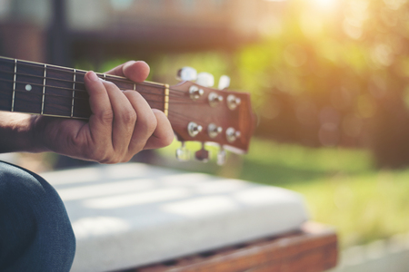 Close up of  man hand playing acoustic guitar. Stock Photo