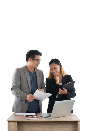 Young business woman standing with her boss conversation about the business at office isolated on white background. Imagens - 77500913
