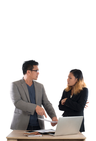 Young business woman standing with her boss conversation about the business at office isolated on white background. Imagens - 77500920