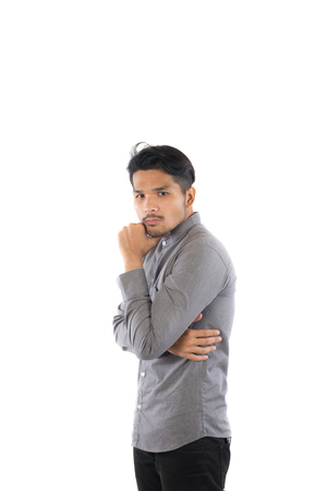 Handsome asian young hipster man standing at studio isolated on white background.