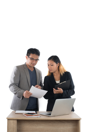 Young business woman standing with her boss conversation about the business at office isolated on white background. Imagens - 77500939