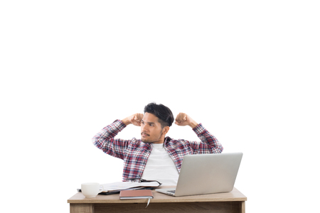 young successful businessman,arms raised celebrating with work isolated on white background. Imagens - 77500942