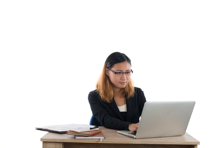 Business woman working on computer isolated on white background. Imagens - 77500944