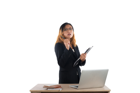 Portrait of businesswoman holding report standing at workplace isolated on white background.