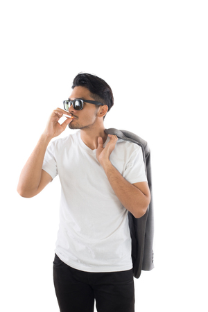 Young Business hipster man smoking a cigarette isolated on white background.