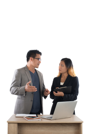 Young business woman standing with her boss conversation about the business at office isolated on white background. Imagens - 77500971