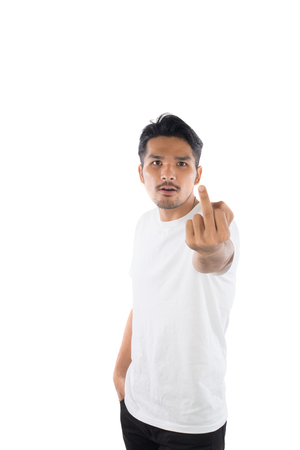 Young handsome man showing middle finger with isolated on white background. Standard-Bild