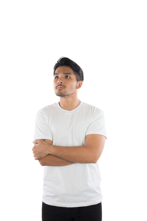 Young handsome man with t-shirt standing arms crossed on isolated white background . Imagens - 77500987