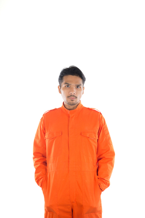 inmate: Prisoner man isolated on white background. Stock Photo