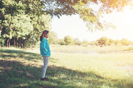 Woman looking away enjoying nature.