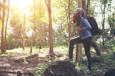 Hipster young woman hiking holiday, wild adventure.
