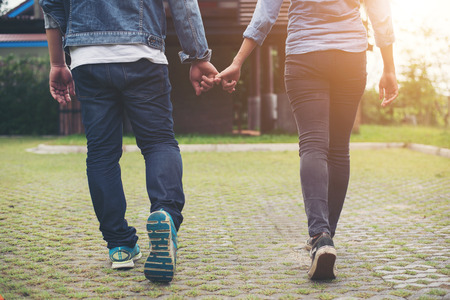 Close-up of loving couple holding hands while walking outdoor, Couple in love concept. Imagens - 77501017
