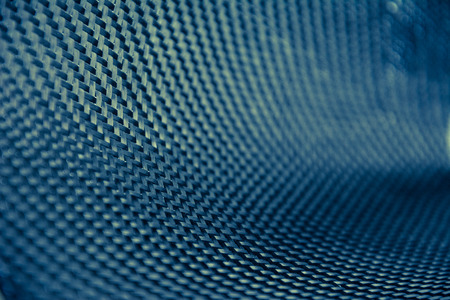 kevlar: black carbon fiber composite raw material background Stock Photo