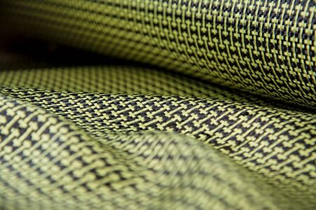 raw material: black carbon fiber composite raw material background Stock Photo