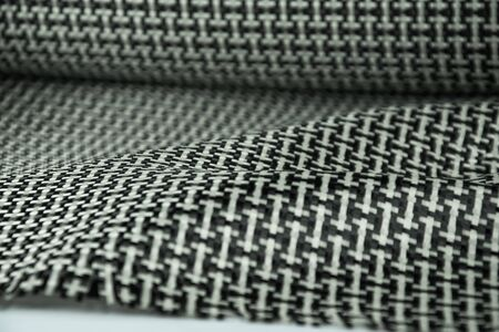 epoxy: black carbon fiber composite raw material background Stock Photo
