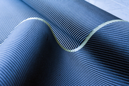 kevlar: Colorful carbon fiber composite raw material background Stock Photo