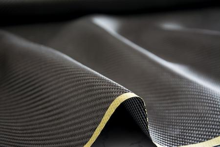 fibra carbono: black carbon fiber composite raw material background Foto de archivo