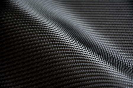 fibra de carbono: black carbon fiber composite raw material background Foto de archivo