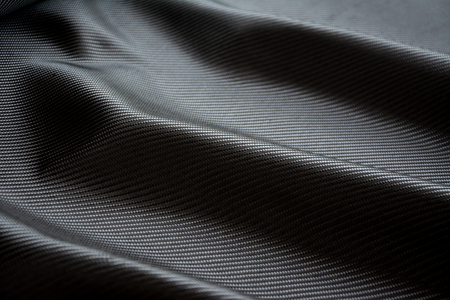 black carbon fiber composite raw material background Reklamní fotografie