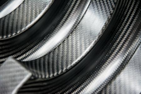 Tło materiału kompozytowego z czarnego włókna węglowego