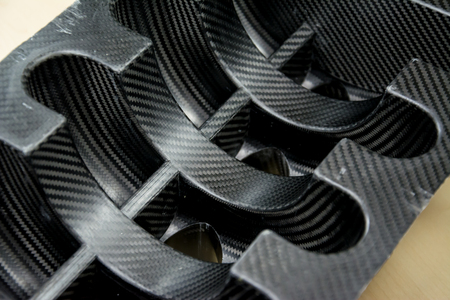 Black carbon fiber composite product material background Reklamní fotografie