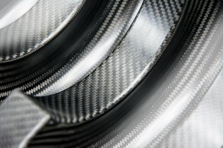 Black carbon fiber composite product material background Standard-Bild
