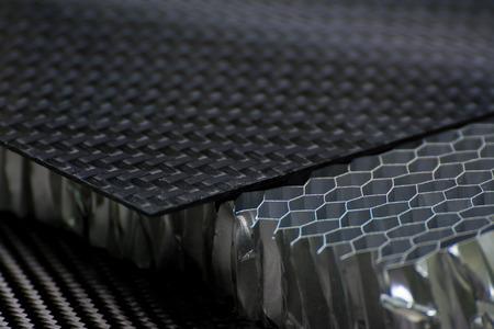 Black carbon fiber composite product material background