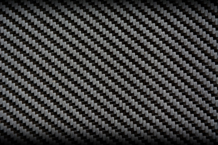 kevlar: Black carbon fiber composite raw material background