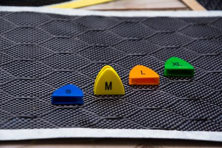 Size number on carbon fiber material background
