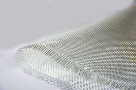 ply: White carbon fiber composite raw material background Stock Photo