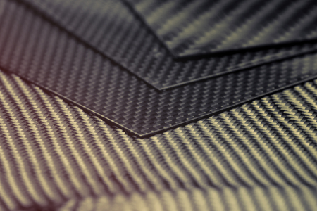 black carbon fiber composite raw material background Stock fotó