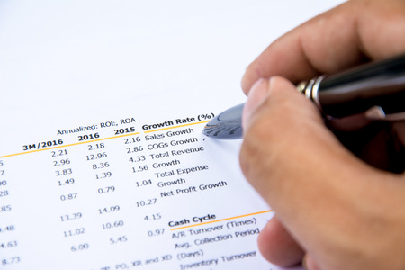 financial budget statement read and check the number for analysis invest stock business target Stock Photo