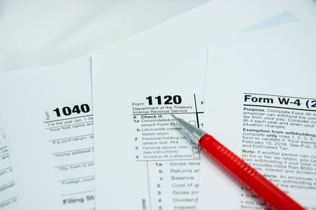 United state tax form with red pen background