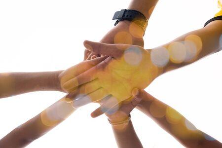 harmonious hand of team work under warm light Stock Photo
