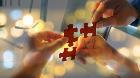 Hand team put missing jigsaw puzzle on the air. Business and technilogy concept use. Stock Photo