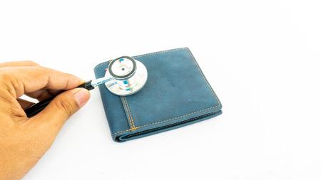 stethoscope check money on empty wallet bag Stock Photo