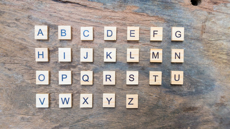 english language text print on square wood block A to Z