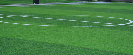 Stadium of football or soccer field with green grass. Sport indoor