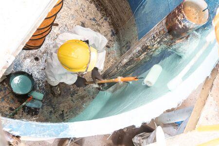 glass fiber material prepare for lining coating repair. scrub waste water tank repair