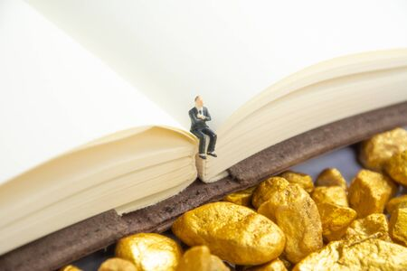 investment concept with graph and account book and  gold stone accessories Reklamní fotografie
