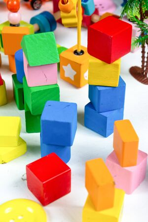 colorful of toys wood for kid playing on white background