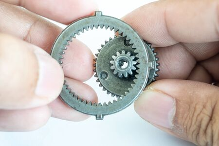 Small gear on hand concept of team driving Standard-Bild - 142932140