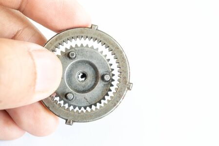 Small gear on hand concept of team driving Standard-Bild - 143079974