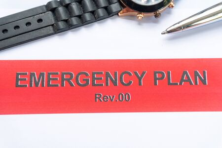 emergency plan book with paper and pen