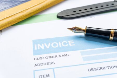 Invoice business document  close up with pen background
