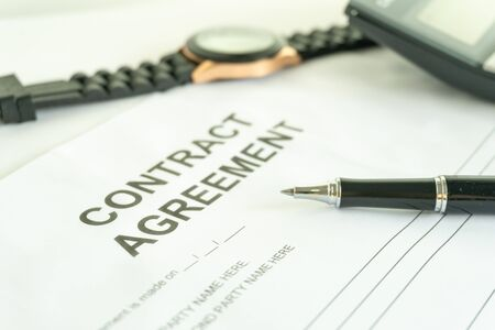 contract agreement document for sign with pen