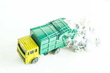Garbage collection truck car for clean paper waste on white floor Standard-Bild - 143079980