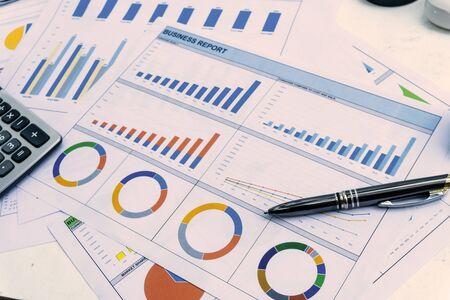 business report with pen statement with graph and data analysis