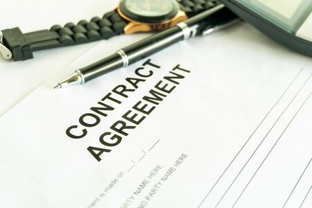 contracts agreement sign on document paper with black pen Standard-Bild