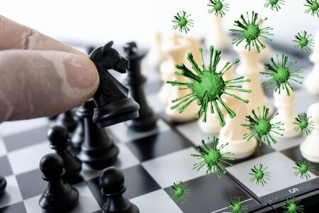 Hand play chess game means fight corona virus
